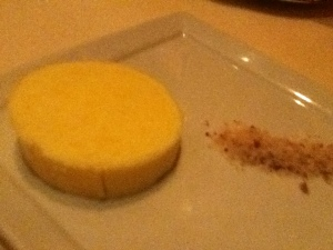 Pat of unsalted butter with coarse sea salt on the side